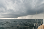 "View of Approaching Storm from Deck of Cutter-rigged Sailboat ""Rachel Kalyn"", offshore from Brant Rock, South Shore, Marshfield, MA"
