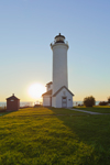 Sun Setting behind Tibbetts Point Lighthouse (Built 1827, rebuilt 1854) at Confluence of Lake Ontario and St Lawrence River, Great Lakes, Cape Vincent, NY