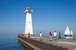 Sailboat and Outer Sodus Lighthouse (Sodus Point Pierhead Light), Sodus Bay on Lake Ontario, Great Lakes Seaway Trail, Sodus, NY