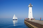 Sailboat and Outer Sodus Lighthouse (Sodus Point Pierhead Light), Sodus Bay on Lake Ontario, Great Lakes Seaway Trail, Sodus, NY