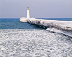 Outer Sodus Lighthouse (Sodus Point Pierhead Light) with Frozen Breakwater, Sodus Bay on Lake Ontario, Sodus, NY,