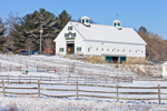 Big White Barn with Pastures and Wooden Fences on Water's Edge Farm in Winter, Concord, MA