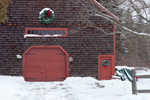 Brown Cedar-shingled Barn with Wreaths and Red Doors at Jonathan Adams House, Medway, Ma