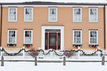 Colonial-style Home with Holiday Decorations on White Fence, Norfolk, MA