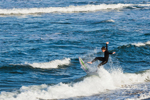 Skimboarder Riding the Waves in Atlantic Ocean near Jennette's Pier, Outer Banks, Nags Head, NC