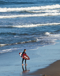Skimboarder at Water's Edge on Beach near Jennette's Pier, Atlantic Ocean, Outer Banks, Nags Head, NC