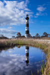 Bodie Island Lighthouse with Reflections in Water Surrounded by Marshes in Early Morning, Cape Hatteras National Seashore, Outer Banks, Bodie Island, NC