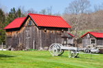 Natural Wooden Barns with Red Roofs and Old Wagon in Spring, Warren, MA