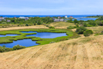 Panoramic View of Ponds, Marshes, Hayed Fields, and Homes with Inlet to Great Salt Pond in Background, Town of New Shoreham, Block Island, RI