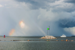 Motor Cruiser on Narragansett Bay with Thunderstorm and Sun Dog at Entrance to Wickford Harbor, Village of Wickford, North Kingstown, RI