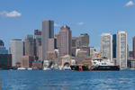 Coast Guard Boat in Boston Harbor with Boston Skyline and Waterfront in Background, Boston, MA