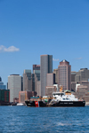 Coast Guard Boat in Boston Harbor with Boston Skyline and Waterfront in Background, Boston, MA