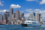 Harbor Express Commuter Ferry in Boston Harbor with Boston Skyline and Waterfront in Background, Boston, MA
