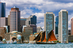 "Wooden Schooner ""Roseway"" under Full Sail in Boston Harbor with Boston Skyline and Waterfront in Background, Boston, MA"