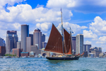 """Wooden Schooner """"Roseway"""" under Sail in Boston Harbor with Boston Skyline and Waterfront in Background, Boston, MA"""