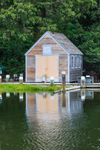 Wooden Boathouse Refecting in Lake Tashmoo, Vineyard Haven, Martha's Vineyard, Tisbury, MA