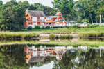 Home with Reflections along Shoreline of Mattituck Inlet, off Long Island Sound, Village of Mattituck, Southold, NY