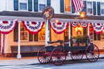 Evening at the Historic Griswold Inn (Built 1776) with Flag Banners and Old Wagon, Griswold Square, Essex, CT