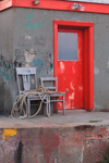 Close Up of Red Door, Gray Chairs, and Graffiti on Commercial Pier at Sakonnet Point, Little Compton, RI