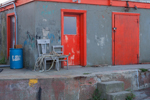 Red Doors, Gray Chairs, Blue Barrel, and Graffiti on Commercial Pier at Sakonnet Point, Little Compton, RI