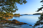 Early Morning Light Shines on Shoreline of Compass Harbor at Dorr Point, Porcupine Islands in Background, Acadia National Park, Mt Desert Island, Bar Harbor, ME