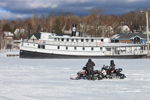 "Tour Boat ""Katahdin Keel"" and Snowmobilers on Iced-over Moosehead Lake in Winter, Greenville, ME"
