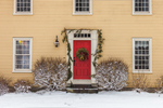 Old New England Colonial House Decorated with Wreath and Garland in Winter, Granby, CT