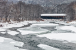 Lincoln Covered Bridge (built 1877) over the Ottauquechee River in Winter, Woodstock, VT