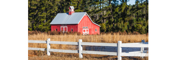 Early Morning Light on Red Barn with Cupola and White Fence near Eagle Neck, South Newport, GA