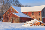 Early Morning Light on Old Red Barn and Newly Cut Logs after Snowstorm, Orange, MA