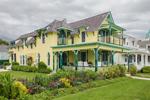 Yellow and Green Gingerbread House with Flower Gardens on Ocean Park, Martha's Vineyard, Oak Bluffs, MA