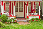 Porch of Red and White Gingerbread House, Martha's Vineyard Camp Meeting Association, National Register of HIstoric Places, Oak Bluffs, MA