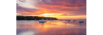 Boats and Colorful Sunset Reflections in Lake Tashmoo, Martha's Vineyard, Tisbury, MA