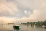 Lifting Fog at Sunset over Boats in Mooring Field in Camden Harbor, Camden, ME