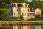 Early Morning Light Shines on Homes on Mystic River, West Mystic, CT