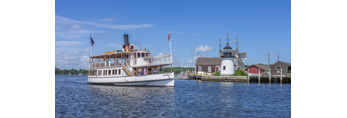 "Tourboat ""Sabino"" Cruising by Replica of Brant Point Lighthouse at Mystic Seaport: The Museum of America and the Sea, Mystic River, Mystic, CT"