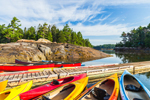Colorful Kayaks on Floats at Mount Desert Campground in Cove off Somes Harbor, Mount Desert Island, Mount Desert, ME