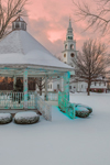 Gazebo with Holiday Lights at Sunset with First Church of Templeton on Templeton Common after Snowstorm, Templeton, MA