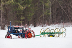 Antique McCormack-Deering Farmall Tractor with Hay Rake in Winter, South Tamworth, NH