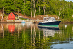 Motor Boat and Little Red Boat House along Hamburg Cove on Eight Mile River, Popular Boating Spot on the Connecticut River, Lyme, CT