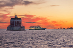 "Montauk Fast Ferry ""Viking Superstar"" near New London Ledge Light at Sunset, Long Island Sound, New London, CT"