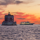 "Montauk Fast Ferry ""Viking Superstar"" near New London Ledge Light at Sunset, Long Island Sound, New London, CT"