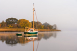 Early Morning Light Shines on Sailboat Anchored in Calm Waters of Connecticut River near Nott Island, Lyme, CT