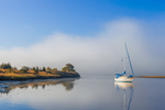 Sailboat in Morning Calm with Lifting Fog Bank on Connecticut River near Nott Island, Lyme, CT