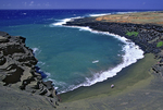 Hikers visit green sand beach, South Point, Big Island, Hawaii