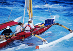 CREW PADDLES SAILING CANOE INTO ALENUIHAHA CHANNEL FROM KEOKEA PARK, BIG ISLAND, HAWAII