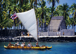 VISITORS SAIL PAST PU'UHONUA O HONAUNAU NHP. ABOARD A DOUBLE HULL SAILING CANOE, HONAUNAU BAY, BIG ISLAND, HAWAII