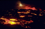 Night time cooling lava with full moon, Hawaii Volcanoes NP., Big Island, Hawaii