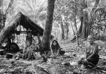 Puluwat Island women & their cook house, Truk, Micronesia