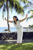 Yoga instructor demonstrates a position, Kona Village Resort, Big Island, Hawaii